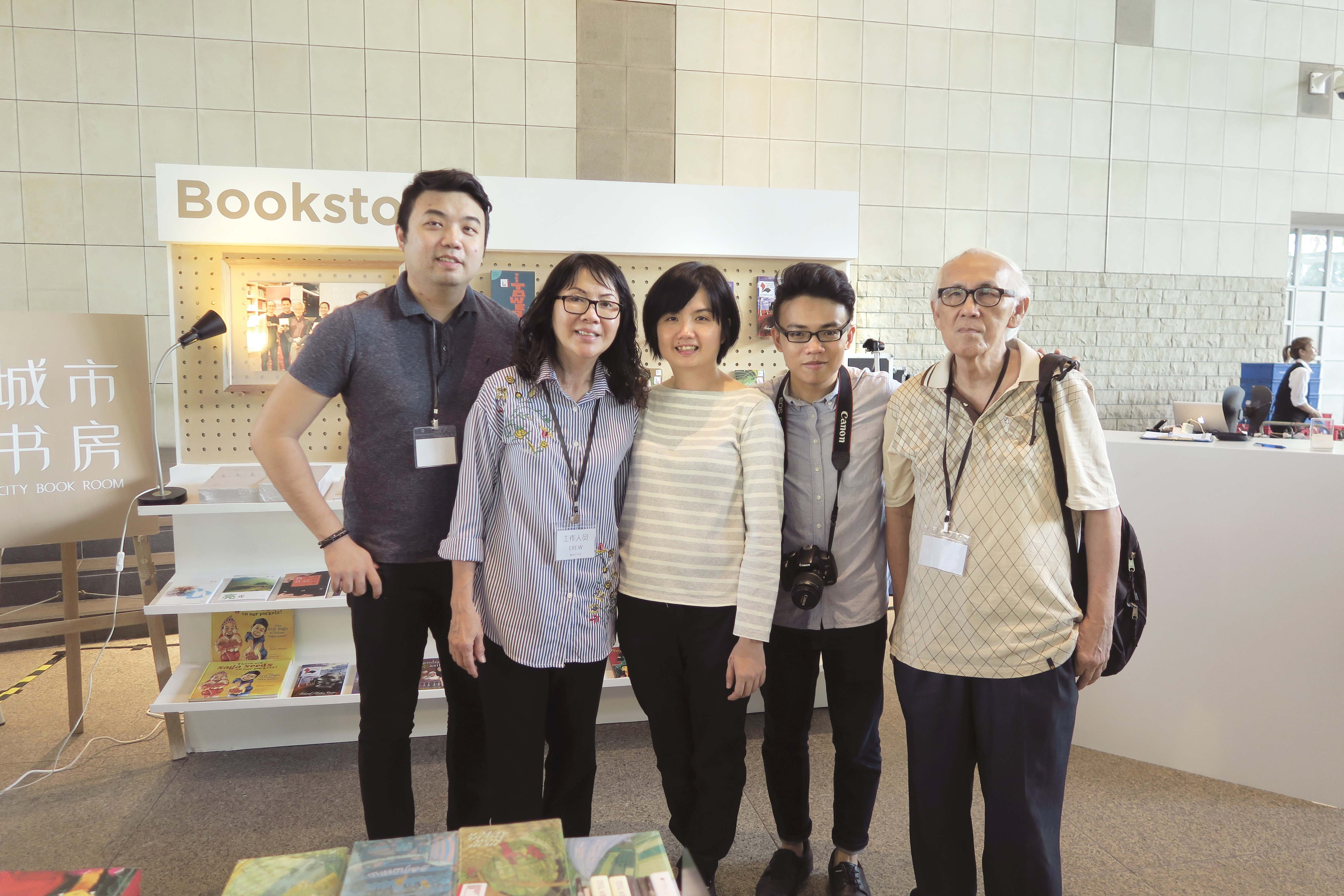 At City Book Room's pop-up store during the National Library Board's Read! Fest 2017, owner Tan Waln Ching (middle) with (from left) her brother, mother, husband Paul Kam, and Chng Ler Thian, who helps to tend to the bookstore